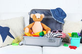 Suitcase packed with clothes — Stock Photo