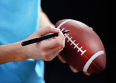 American football star signing autograph — Stock Photo