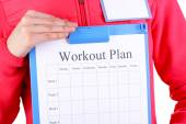 Trainer with personal workout plan — Stock Photo