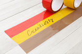 Bonded tape with creativity woprd — Stock Photo