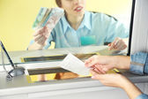 Teller window with working cashier  — Stock Photo