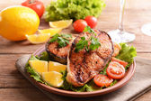 Tasty baked fish on plate on table close-up — Stok fotoğraf