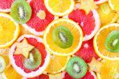 Sliced fruits background — Stock Photo