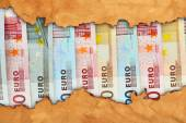 Euro banknotes in torn craft paper frame — Stock Photo