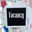 Signboard with text Vacancy near hotel — Stock Photo #65339249