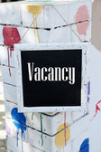 Signboard with text Vacancy near hotel — Stock Photo