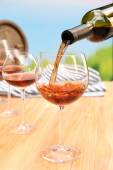 Red wine pouring into wine glass, close-up — Stock Photo
