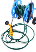 Garden hose on wheels isolated on white — Stock Photo