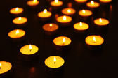 Burning candles in dark — Stock Photo
