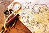 Spyglass and world map — Stock Photo