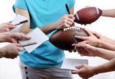 白い背景に分離されたアメリカン フットボールのスターのサイン — ストック写真