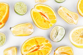 Squeezed citrus fruits isolated on white — Stock Photo