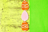 Felt Easter eggs on colorful wooden background — Stock Photo