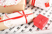 Handmade gifts on Valentine Day, on fabric background — Stock fotografie