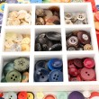 Various of sewing buttons in box on white background, macro view — Stock Photo #65403807