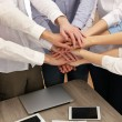 United hands of business team on workspace background — Stock Photo #65406107
