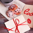 Love letters with coffee and cookies on wooden background — Stock Photo #65407247