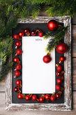 Menu board with Christmas decoration on wooden planks background — Zdjęcie stockowe