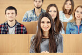 Group of students sitting in classroom — Стоковое фото