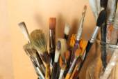 Different paintbrushes on wooden background — Stock Photo