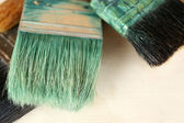 Different paintbrushes on fabric background — Stok fotoğraf
