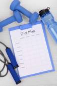 Diet plan and sports equipment top view close-up  — Stock Photo