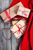 Love letters with gifts on wooden background — Zdjęcie stockowe