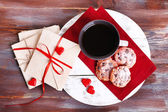 Love letters with coffee and cookies on wooden background — Stock Photo