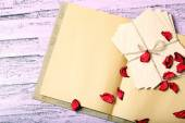 Love letters and rose petals on wooden background — Zdjęcie stockowe
