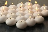 Burning candles on wooden table close-up — Stock Photo