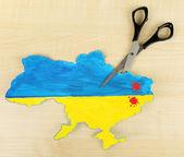 Map of Ukraine and scissors — Stock Photo