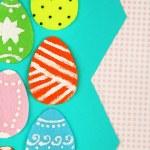 Felt Easter eggs on craft paper background — Stock Photo #65423715