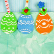 Felt Easter eggs on craft colorful background — Stock Photo #65423737