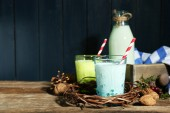 Fresh milk with natural decor, on wooden background — Stock Photo