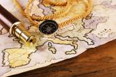 Marine still life with world map and spyglass on wooden table background — Stock Photo