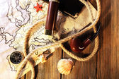 Marine still life spyglass and world map on wooden background — Stock Photo