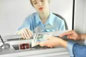 Teller window with working cashier  — Stok fotoğraf