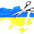 Map of Ukraine and scissors, isolated on white- concept of disintegration of the country — Stock Photo #65506791
