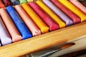 Colorful chalk pastels in box on table close up — Stock Photo