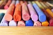 Colorful chalk pastels in box close up — 图库照片
