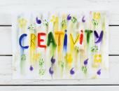 Word creativity written on paper on wooden background — Stock Photo
