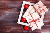 Love letters with gift on wooden background — Stock Photo