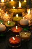 Burning candles in glass candlesticks close-up — Stock Photo