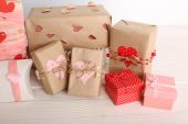 Beautiful gift boxes on wooden background. Valentine Day concept — Stock Photo