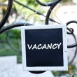 Signboard with text Vacancy near hotel — Stock Photo #65643961