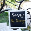 Signboard with text Sorry No Vacancy near hotel — Stock Photo #65644147