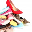 Pile of various female shoes isolated on white — Stock Photo #65646791