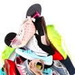 Pile of various female shoes isolated on white — Stock Photo #65646797