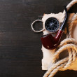Marine still life pipe, compass, rope and sheet of paper on wooden background — Stock Photo #65647291