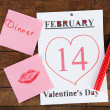 Valentines Day, February 14 on calendar on wooden background — Stock Photo #65647327